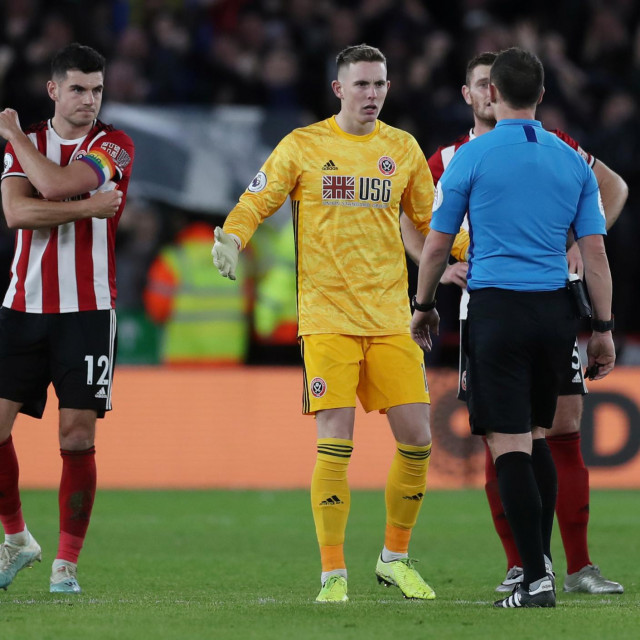 """Soccer Football - Premier League - Sheffield United v Newcastle United - Bramall Lane, Sheffield, Britain - December 5, 2019 Sheffield United's Dean Henderson remonstrates with referee Stuart Attwell after a goal was awarded to Newcastle by VAR Action Images via Reuters/Lee Smith EDITORIAL USE ONLY. No use with unauthorized audio, video, data, fixture lists, club/league logos or """"live"""" services. Online in-match use limited to 75 images, no video emulation. No use in betting, games or single club/league/player publications. Please contact your account representative for further details."""