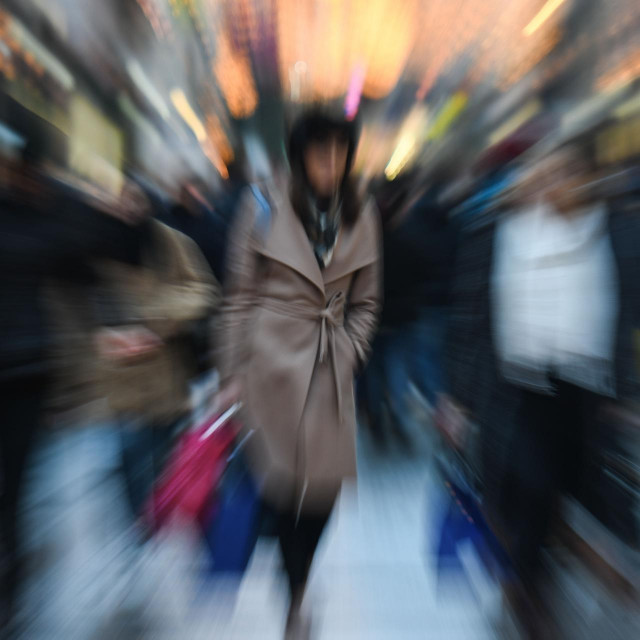A young woman carries a shopping bag along Regent Street in London, England, on December 7, 2018. Christmas shopping season is in full swing in London with just over two weeks to go before the 25th, and with retailers hoping for strong sales to finish a year that has seen many household names fall into serious financial difficulties. (Photo by David Cliff/NurPhoto)