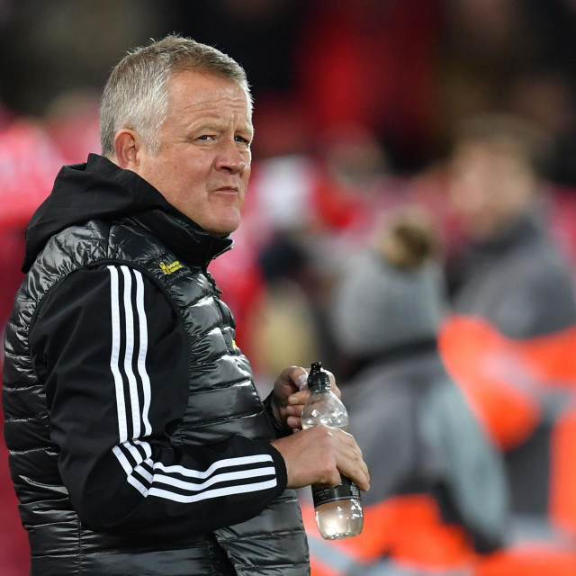 Sheffield United's English manager Chris Wilder looks on before the English Premier League football match between Liverpool and Sheffield United at Anfield in Liverpool, north west England on January 2, 2020. (Photo by Paul ELLIS/AFP)/RESTRICTED TO EDITORIAL USE. No use with unauthorized audio, video, data, fixture lists, club/league logos or 'live' services. Online in-match use limited to 120 images. An additional 40 images may be used in extra time. No video emulation. Social media in-match use limited to 120 images. An additional 40 images may be used in extra time. No use in betting publications, games or single club/league/player publications./