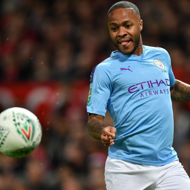 Manchester City's English midfielder Raheem Sterling controls the ball during the English League Cup semi-final first leg football match between Manchester United and Manchester City at Old Trafford in Manchester, north west England on January 7, 2020. (Photo by Paul ELLIS/AFP)/RESTRICTED TO EDITORIAL USE. No use with unauthorized audio, video, data, fixture lists, club/league logos or 'live' services. Online in-match use limited to 75 images, no video emulation. No use in betting, games or single club/league/player publications./