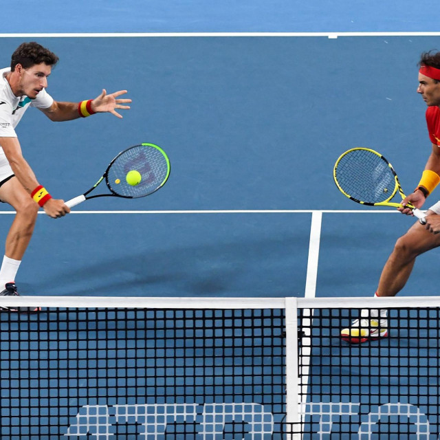 Rafael Nadal (R) and Pablo Carreno Busta (L) of Spain return the ball in their men's double match against Sander Gille and Joran Vliegen of Belgium at the ATP Cup tennis tournament in Sydney on January 10, 2020. (Photo by William WEST/AFP)/--IMAGE RESTRICTED TO EDITORIAL USE - NO COMMERCIAL USE--