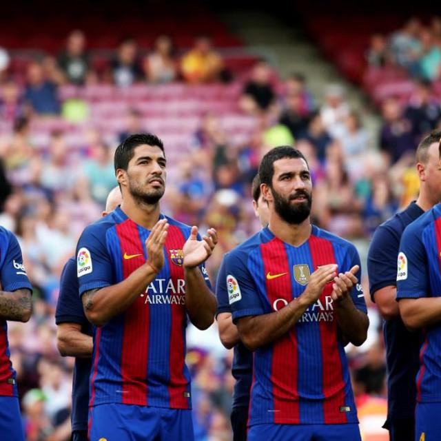 Cristian Tello, Luis Suarez, Arda Turan and Ivan Rakitic during the presentation of the Barcelona team 2016-17, held in the Camp Nou stadium, on august 10, 2016. (Photo by Urbanandsport/NurPhoto)
