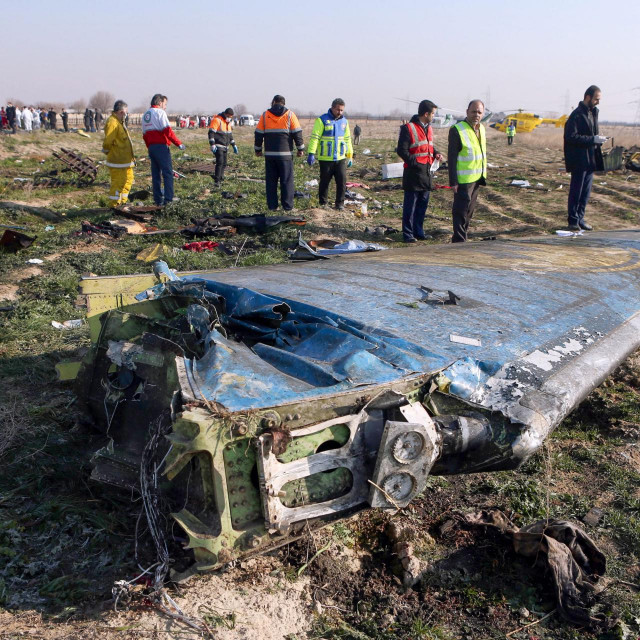 (FILES) In this file photo taken on January 8, 2020 rescue teams are seen at the scene of a Ukrainian airliner that crashed shortly after take-off near Imam Khomeini airport in the Iranian capital Tehran. - Iran said on January 11 that it unintentionally shot down the Ukrainian plane due to 'human error'. (Photo by Akbar TAVAKOLI/IRNA/AFP)