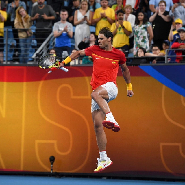 Rafael Nadal of Spain leaps for joy after winning his men's singles match against Alex de Minaur of Australia at the ATP Cup tennis tournament in Sydney on January 11, 2020. (Photo by William WEST/AFP)/--IMAGE RESTRICTED TO EDITORIAL USE - NO COMMERCIAL USE--