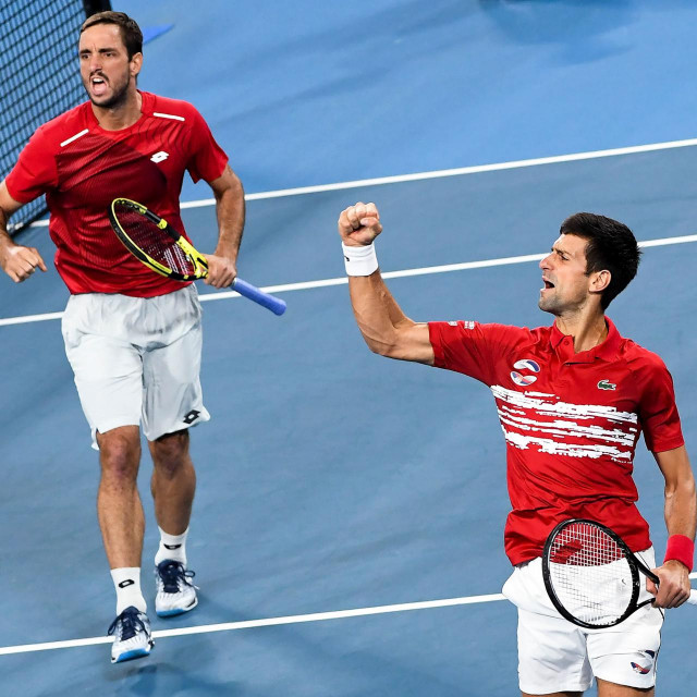 CORRECTION - Viktor Troicki (L) and Novak Djokovic (R) of Serbia celebrate winning the first set in their men's doubles match against Pablo Carreno Busta and Feliciano Lopez of Spain in the final of the ATP Cup tennis tournament in Sydney on January 13, 2020. (Photo by William WEST/AFP)/-- IMAGE RESTRICTED TO EDITORIAL USE - STRICTLY NO COMMERCIAL USE --/�The erroneous mention[s] appearing in the metadata of this photo by William WEST has been modified in AFP systems in the following manner: [13] instead of [12]. Please immediately remove the erroneous mention[s] from all your online services and delete it (them) from your servers. If you have been authorized by AFP to distribute it (them) to third parties, please ensure that the same actions are carried out by them. Failure to promptly comply with these instructions will entail liability on your part for any continued or post notification usage. Therefore we thank you very much for all your attention and prompt action. We are sorry for the inconvenience this notification may cause and remain at your disposal for any further information you may require.�