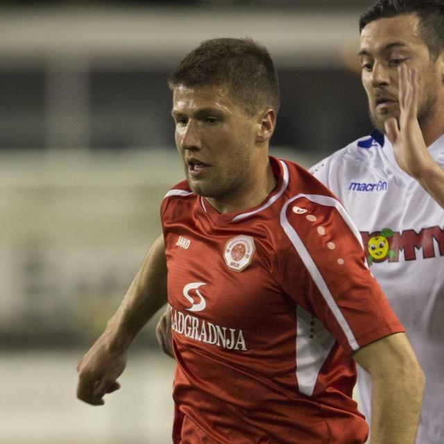 Split, 040415<br /> Stadion u Poljudu<br /> MaxTV 1. liga 27. kolo utakmica: HNK Hajduk - RNK Split (1:2)<br /> Na fotografiji: Nino Galovic (Split) i Artem Milevskyi (Hajduk).<br />