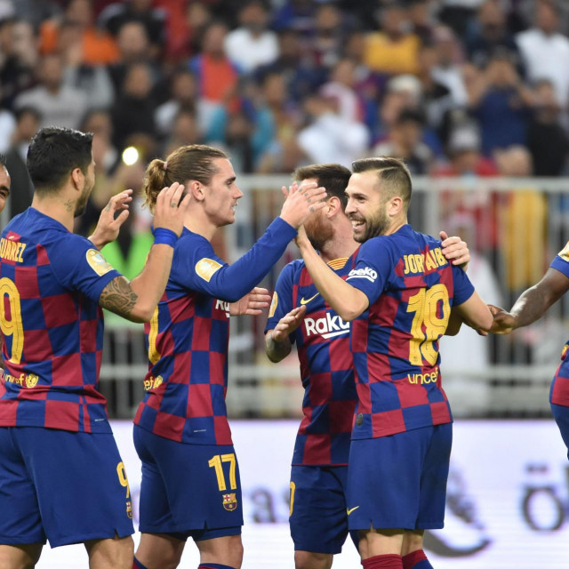 Barcelona's players celebrate their goal during the Spanish Super Cup semi final between Barcelona and Atletico Madrid on January 9, 2020, at the King Abdullah Sport City in the Saudi Arabian port city of Jeddah. - The winner will face Real Madrid in the final on January 12. (Photo by FAYEZ NURELDINE/AFP)