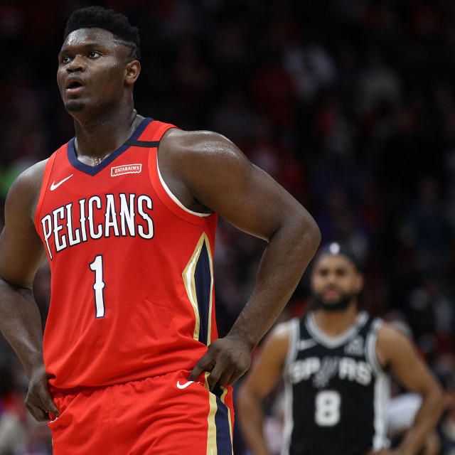 NEW ORLEANS, LOUISIANA - JANUARY 22: Zion Williamson #1 of the New Orleans Pelicans looks on during the game against the San Antonio Spurs at Smoothie King Center on January 22, 2020 in New Orleans, Louisiana. NOTE TO USER: User expressly acknowledges and agrees that, by downloading and/or using this photograph, user is consenting to the terms and conditions of the Getty Images License Agreement. Chris Graythen/Getty Images/AFP<br /> == FOR NEWSPAPERS, INTERNET, TELCOS & TELEVISION USE ONLY ==