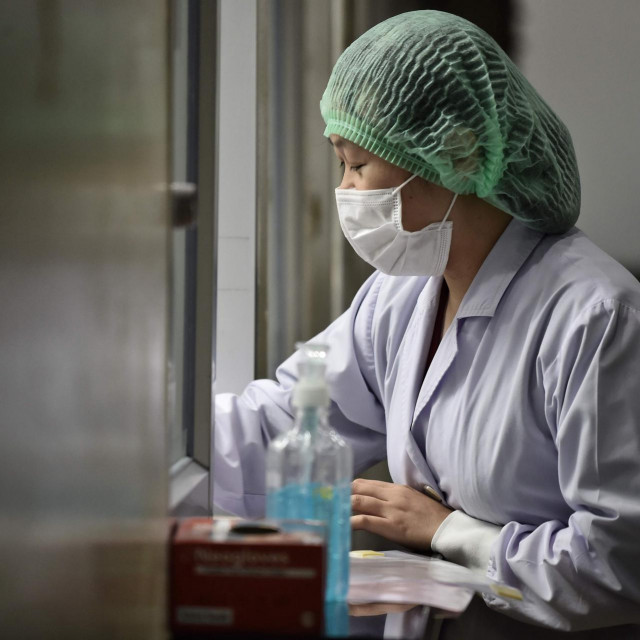 A lab technician registers samples from potential victims of the novel coronavirus at the Centre for Emerging Infectious Diseases of Thailand at Chulalongkorn University in Bangkok on February 5, 2020. - Thailand so far has detected 25 confirmed cases of the novel coronavirus believed to have originated in the central Chinese city of Wuhan, which is under lockdown. (Photo by Lillian SUWANRUMPHA/AFP)