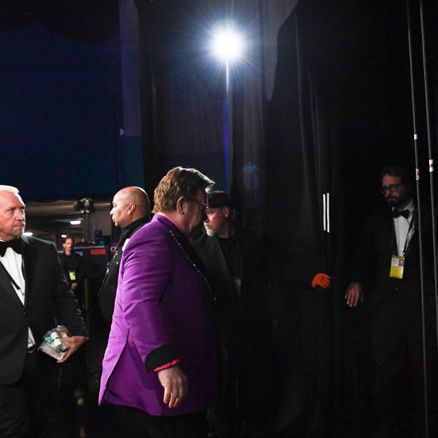 "In this photo provided by A.M.P.A.S., Elton John walks to the main stage during the 92nd Oscars at the Dolby Theatre in Hollywood, California on February 9, 2020. (Photo by Richard Harbaugh/AMPAS/AFP)/RESTRICTED TO EDITORIAL USE - MANDATORY CREDIT ""AFP PHOTO/AMPAS/ Richard HARBAUGH"" - NO MARKETING - NO ADVERTISING CAMPAIGNS - DISTRIBUTED AS A SERVICE TO CLIENTS"