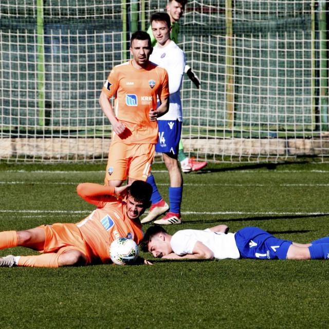 Split,150220<br /> Pomocni stadion u Poljudu, prijateljska utakmica: HNK Hajduk II - NK Sibenik.<br /> Na fotografiji: Bulat, Kukec i Saric.<br />
