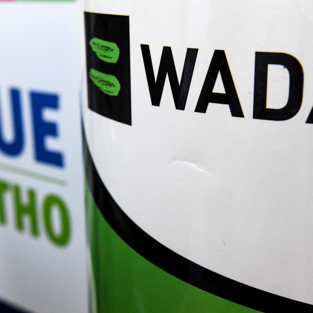 The World Anti-Doping Agency or WADA logo is pictured at the Russkaya Zima (Russian Winter) Athletics competition in Moscow on February 9, 2020. - The entire board of Russia's athletics federation has resigned as the government attempts to find a way out of the country's deepening doping crisis before this year's Olympic Games. (Photo by Kirill KUDRYAVTSEV/AFP)