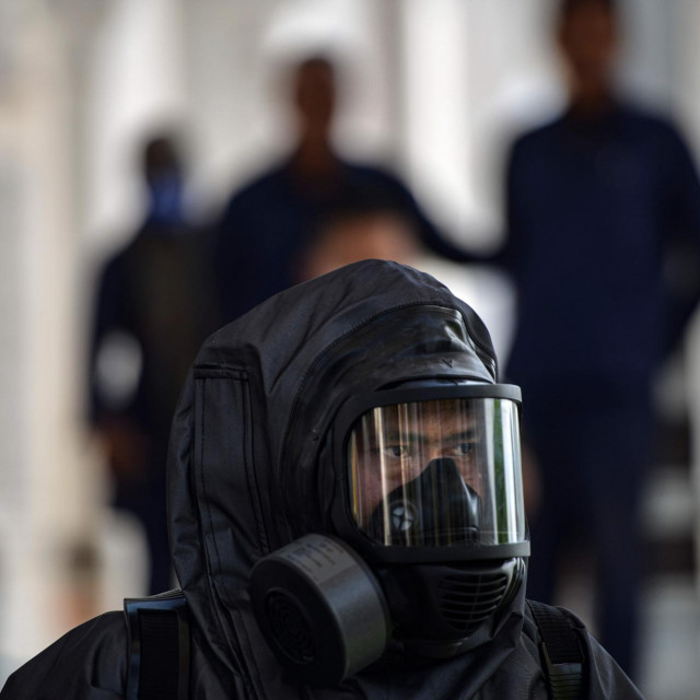 An Indonesian police officer prepares to spray disinfectant in the Baiturrahman grand mosque, amid concerns of the COVID-19 coronavirus, in Banda Aceh on March 20, 2020. (Photo by CHAIDEER MAHYUDDIN/AFP)