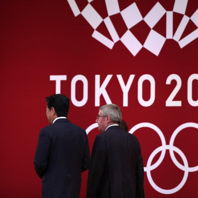 "(FILES) In this file photo taken on July 24, 2019 International Olympic Committee president Thomas Bach (R) walks with Japan's Prime Minister Shinzo Abe (L) as they leave the stage during a ceremony marking one year before the start of the Tokyo 2020 Olympic Games in Tokyo. - apan has asked for a one-year postponement of the Tokyo 2020 Games over the global coronavirus pandemic, and the International Olympic Committee has agreed, the country's prime minister said on March 24, 2020. ""I proposed to postpone for about a year and president Bach responded with 100 percent agreement,"" Shinzo Abe told reporters referring to Thomas Bach, head of the IOC. (Photo by Behrouz MEHRI/AFP)"
