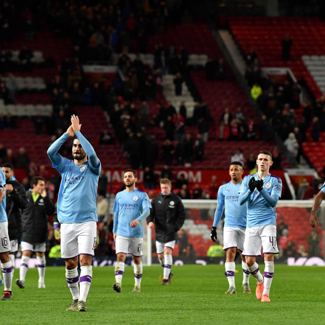 Manchester City's German midfielder Ilkay Gundogan (2L) applauds the fans following the English League Cup semi-final first leg football match between Manchester United and Manchester City at Old Trafford in Manchester, north west England on January 7, 2020. - Manchester City won the match 3-1. (Photo by Paul ELLIS/AFP)/RESTRICTED TO EDITORIAL USE. No use with unauthorized audio, video, data, fixture lists, club/league logos or 'live' services. Online in-match use limited to 75 images, no video emulation. No use in betting, games or single club/league/player publications./