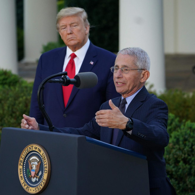 US President Donald Trump listens as Director of the National Institute of Allergy and Infectious Diseases Dr. Anthony Fauci speaks during a Coronavirus Task Force press briefing in the Rose Garden of the White House in Washington, DC, on March 30, 2020.