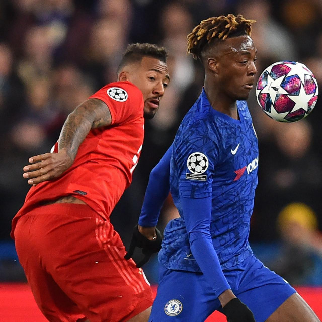 Chelsea's English striker Tammy Abraham (R) vies with Bayern Munich's German defender Jerome Boateng during the UEFA Champion's League round of 16 first leg football match between Chelsea and Bayern Munich at Stamford Bridge in London on February 25, 2020. (Photo by Glyn KIRK/AFP)