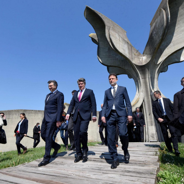Croatian Pariament Speaker Gordan Jandrokovic (R), Croatian President Zoran Milanovic (C) and Croatian Prime Minister Andrej Plenkafterovic (L) leave the flower-shaped monument after a ceremony in tribute to tens of thousands of victims killed in the concentration camp of Jasenovac during the World War II, on April 22, 2020. - Croatia's Jews, Serbs and Roma joined an official commemoration for the victims of a World War II death camp for the first time in five years Wednesday, after snubbing the event to protest a resurgence of Nazi ideology. Known as Croatia's Auschwitz, the Jasenovac camp was run by the Nazi-allied Ustasha regime, which persecuted and killed hundreds of thousands of ethnic Serbs, Jews, Roma and anti-fascist Croatians during the war. (Photo by Denis LOVROVIC/AFP)