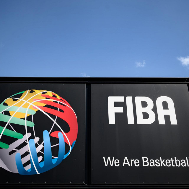 A picture taken on April 24, 2020 in Mies, shows a board at the entrance of the International Basketball Federation FIBA, as Switzerland remains in lockdown during the COVID-19 outbreak, caused by the novel coronavirus. - Short-time working, drawdowns from reserves, bank loans or call for help to the Intenational Olympic Committee, the hitherto prosperous international sports federations are suffering from the cancellation or postponement of their events caused by the coronavirus pandemic, which deprives them of income. (Photo by Fabrice COFFRINI/AFP)
