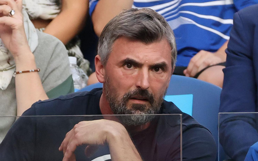Croatia's former tennis player Goran Ivanisevic (bottom C) watches the men's singles semi-final match between Switzerland's Roger Federer and Serbia's Novak Djokovic on day eleven of the Australian Open tennis tournament in Melbourne on January 30, 2020. (Photo by DAVID GRAY/AFP)/IMAGE RESTRICTED TO EDITORIAL USE - STRICTLY NO COMMERCIAL USE
