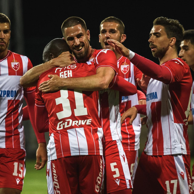"""Red Star's Milos Degenek celebrates with his team mates after scoring a goal during the football match between FC Rad and FC Crvena Zvezda (FC Red Star) at the """"King Petar I"""" stadium in Belgrade on May 29, 2020, as Serbia's first and second division resumed today behind closed doors, after it was stoped due to the COVID-19 pandemic in mid-March. (Photo by Andrej ISAKOVIC/AFP)"""