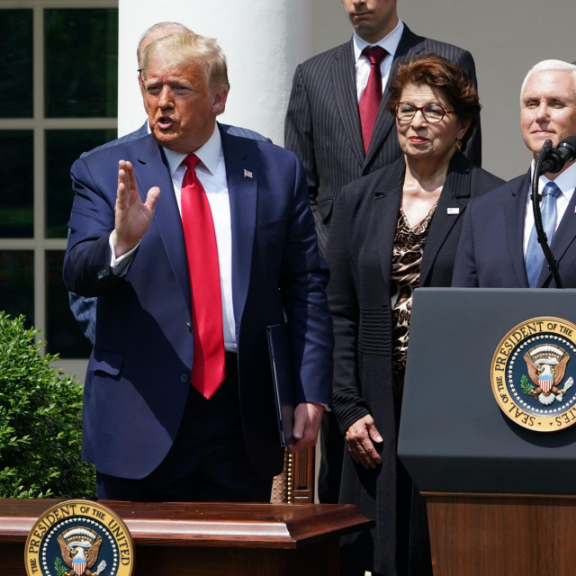US President Donald Trump, with US Vice President Mike Pence (R), speaks after signing the Paycheck Protection Program Flexibility Act of 2020, during a press conference on the economy, in the Rose Garden of the White House in Washington, DC, on June 5, 2020. - The US economy regained 2.5 million jobs in May as coronavirus pandemic shutdowns began to ease, sending the unemployment rate falling to 13.3 percent, the Labor Department reported on June 5. (Photo by MANDEL NGAN/AFP)