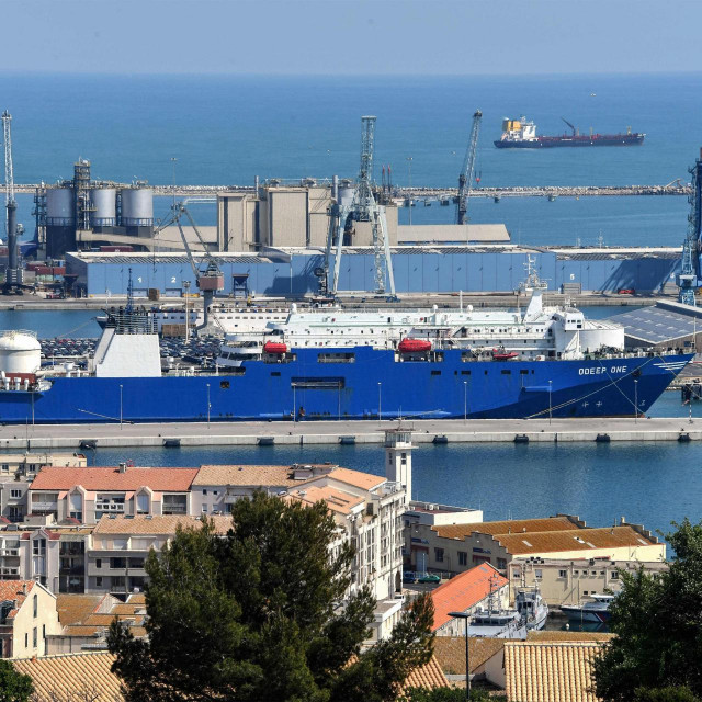 "A picture taken on April 2, 2020 shows the factory boat ""Odeep One"" moored at Sete harbour. - On board, 39 confined firefighters and chemists ensure continuous production of hydroalcoholic solution. (Photo by Pascal GUYOT/AFP)"