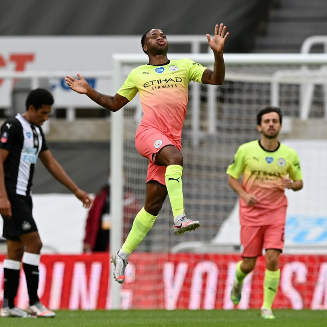 Manchester City's English midfielder Raheem Sterling (C) celebrates scoring his team's second goal during the English FA Cup quarter-final football match between Newcastle United and Manchester City at St James' Park in Newcastle-upon-Tyne, north east England on June 28, 2020. (Photo by Shaun Botterill/POOL/AFP)/RESTRICTED TO EDITORIAL USE. No use with unauthorized audio, video, data, fixture lists, club/league logos or 'live' services. Online in-match use limited to 120 images. An additional 40 images may be used in extra time. No video emulation. Social media in-match use limited to 120 images. An additional 40 images may be used in extra time. No use in betting publications, games or single club/league/player publications./