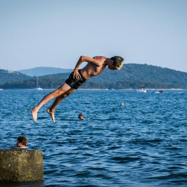 Sibenik, 020720.<br /> Sibencani uzivaju u ljetu i kupanju u moru ugodne temperature.<br />