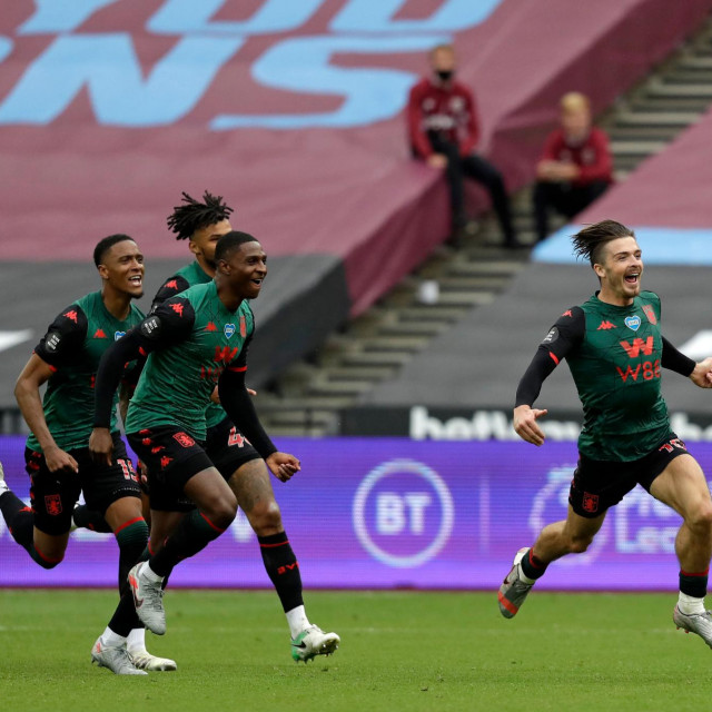 Aston Villa's English midfielder Jack Grealish (R) runs to celebrate scoring the opening goal during the English Premier League football match between West Ham United and Aston Villa at The London Stadium, in east London on July 26, 2020. (Photo by Matt Dunham/POOL/AFP)/RESTRICTED TO EDITORIAL USE. No use with unauthorized audio, video, data, fixture lists, club/league logos or 'live' services. Online in-match use limited to 120 images. An additional 40 images may be used in extra time. No video emulation. Social media in-match use limited to 120 images. An additional 40 images may be used in extra time. No use in betting publications, games or single club/league/player publications./