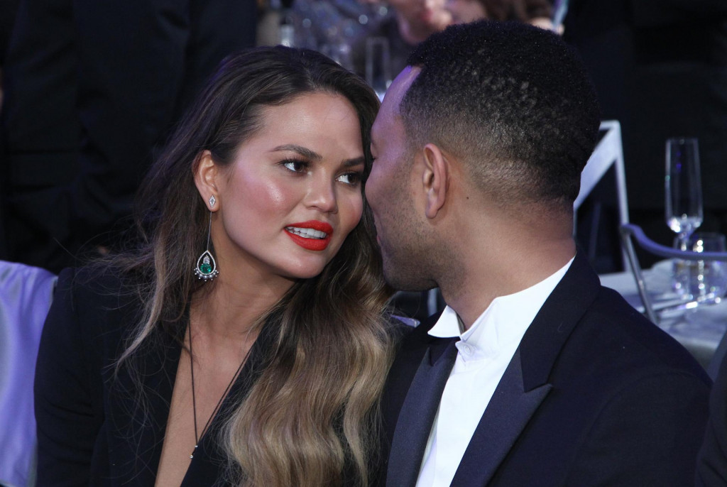 Recording artist John Legend (R) and Chrissy Teigen attend the 23rd Annual Screen Actor Guild Awards at The Shrine Expo Hall on January 29, 2017 in Los Angeles, California. (Photo by Tommaso Boddi/Š2017 SAG-AFTRA/AFP)/Š2017 SAG-AFTRA/AFP/ANGELA WEISS