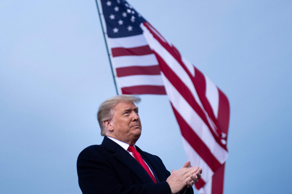 """US President Donald Trump arrives for a """"Great American Comeback"""" rally in Fayetteville, North Carolina, on September 19, 2020. (Photo by Brendan Smialowski/AFP)"""