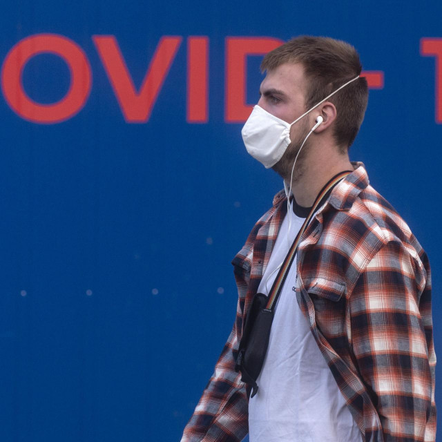 """A man wearing a face mask walks past a COVID-19/coronavirus testing station on September 24, 2020 in Prague. - Seven European Union countries -- Spain, Romania, Bulgaria, Croatia, Hungary, Czech Republic and Malta -- are of """"high concern"""" due to rising Covid-19 death rates, the European Centre for Disease Control and Prevention warned Thursday, September 24, 2020. (Photo by Michal Cizek/AFP)"""