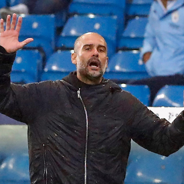 Manchester City's Spanish manager Pep Guardiola gestures on the touchline during the English Premier League football match between Leeds United and Manchester City at Elland Road in Leeds, northern England on October 3, 2020. (Photo by JASON CAIRNDUFF/POOL/AFP)/RESTRICTED TO EDITORIAL USE. No use with unauthorized audio, video, data, fixture lists, club/league logos or 'live' services. Online in-match use limited to 120 images. An additional 40 images may be used in extra time. No video emulation. Social media in-match use limited to 120 images. An additional 40 images may be used in extra time. No use in betting publications, games or single club/league/player publications./