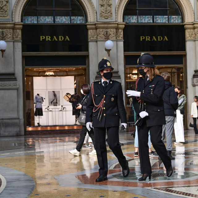 Police officers wearing protective masks walk across the Galleria Vittorio Emanuele II in Milan on October 17, 2020, amid the Covid-19 pandemic. - Italy's government has made it mandatory to wear face protection outdoors, in an attempt to counter the spread of the coronavirus Covid-19 pandemic. (Photo by MIGUEL MEDINA/AFP)