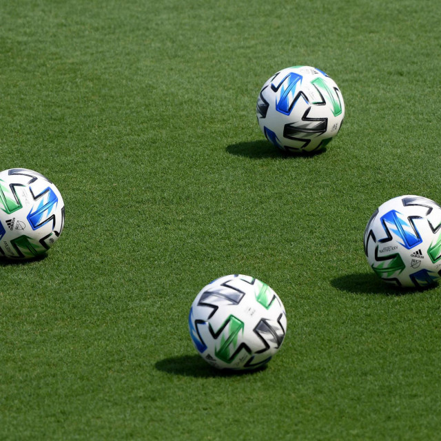 LOS ANGELES, CALIFORNIA - AUGUST 22: Soccer balls on the field before the season opening game between the Los Angeles Galaxy and the Los Angeles FC at Banc of California Stadium on August 22, 2020 in Los Angeles, California. Harry How/Getty Images/AFP<br /> == FOR NEWSPAPERS, INTERNET, TELCOS & TELEVISION USE ONLY ==