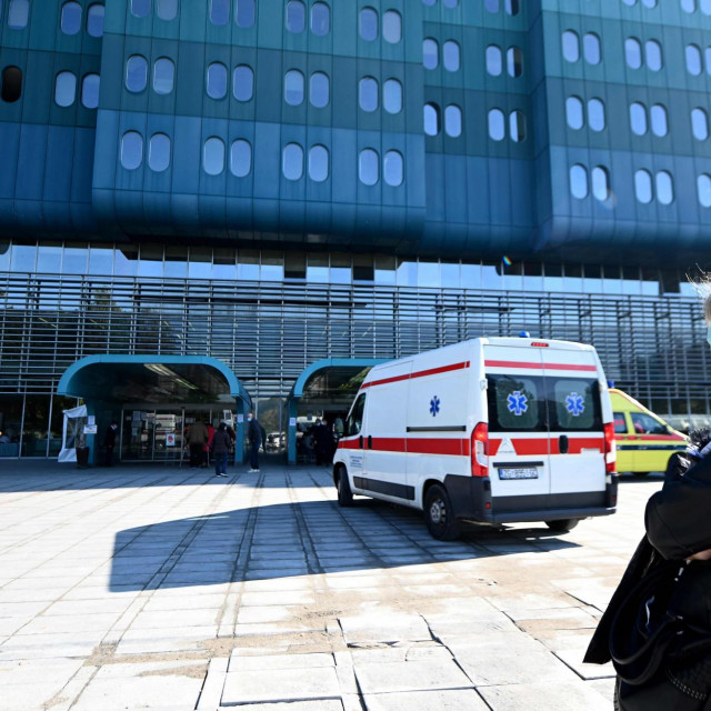 A woman wearing a face mask waits to be admitted to the Dubrava Clinical Hospital in Zagreb on October 19, 2020, amid the Covid-19 pandemic, caused by the novel coronavirus. - Croatia has seen a surge in coronavirus infections and authorities have expressed concern over the lack of capacity in the country's overloaded hospitals. A large number of hospital staff have been infected or are in self-isolation. (Photo by DENIS LOVROVIC/AFP)