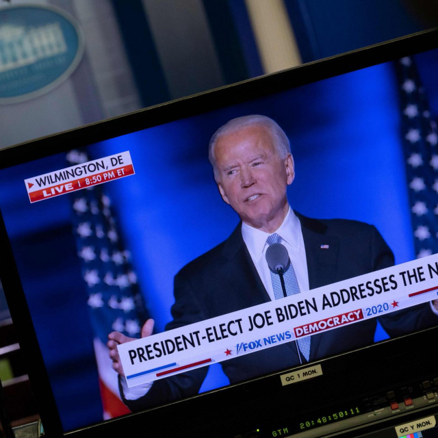 US President-elect Joe Biden is seen, as he give his acceptance speech, on a monitor in the Brady Briefing Room in the White House in Washington, DC on November 7, 2020. (Photo by ANDREW CABALLERO-REYNOLDS/AFP)