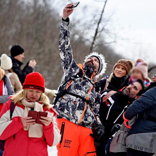 Mnoštvo posjetitelja u NP Plitvička jezera koja su pod snijegom