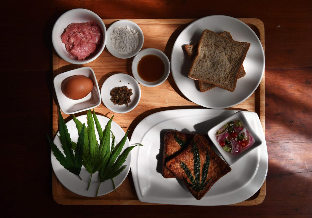 This photo taken on January 15, 2021 shows pork on bread with cannabis leaves laid out with ingredients at the Abhaibhubejhr Spa Cuisine restaurant at the Abhaibhubejhr Day Spa, next to Chao Phraya Aphaiphubet Hospital in Prachinburi. (Photo by Lillian SUWANRUMPHA/AFP)