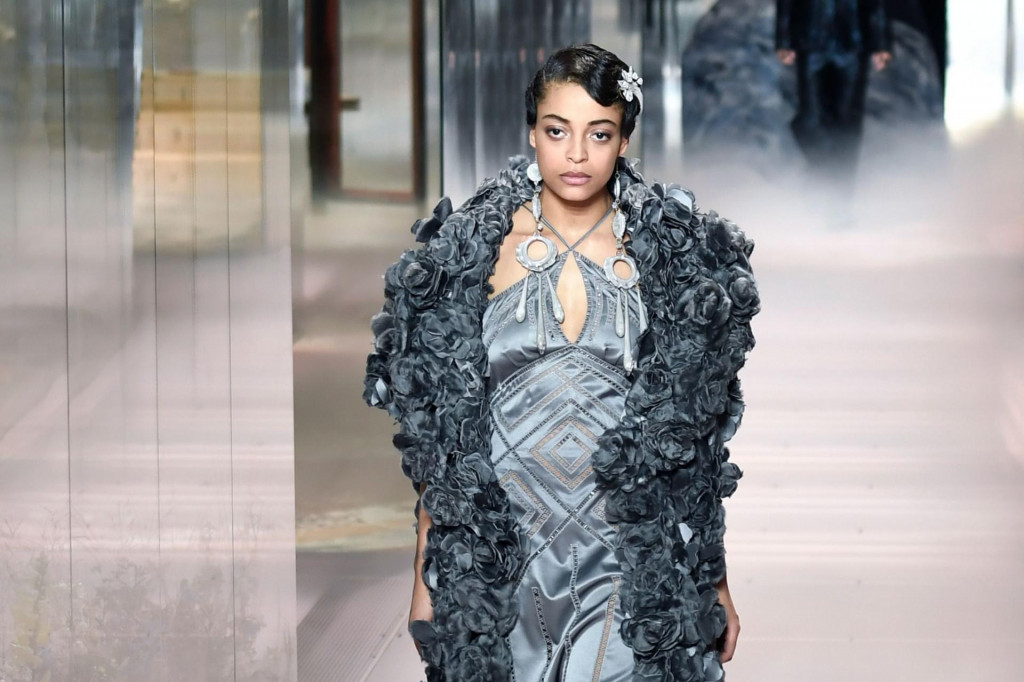 A model presents a creation of British designer Kim Jones for the Fendi's Spring-Summer 2021 collection during the Paris Haute Couture Fashion Week, in Paris, on January 27, 2021. - British designer Kim Jones presents his first ever Couture Collection for Fendi since he joinded Italian fashion house Fendi as its lead designer for womenswear in September 2020. (Photo by STEPHANE DE SAKUTIN/AFP)