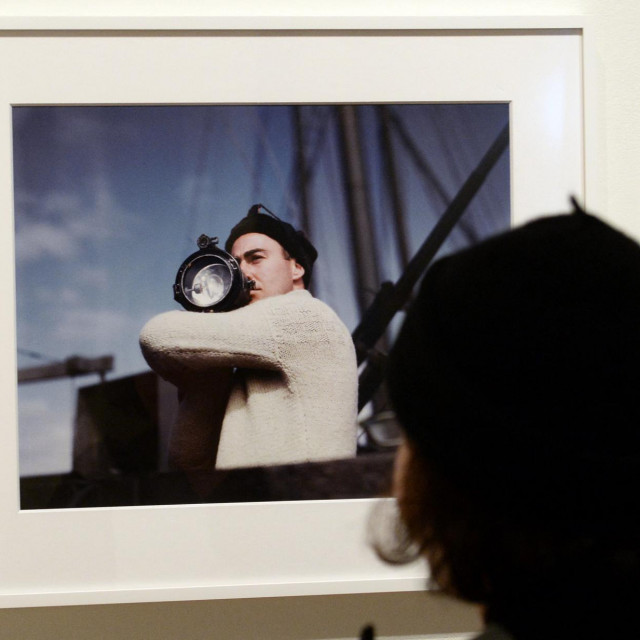 """A visitor looks at """"Capa in Color"""" exhibition at the International Center of Photography in New York, January 30, 2014. Capa in Color is the first full assessment of color photographs by fames US photographer Robert Capa and will run from January 31 to May 4, 2014. """"MANDATORY MENTION OF THE ARTIST UPON PUBLICATION"""" AFP PHOTO/Emmanuel Dunand (Photo by EMMANUEL DUNAND/AFP)"""