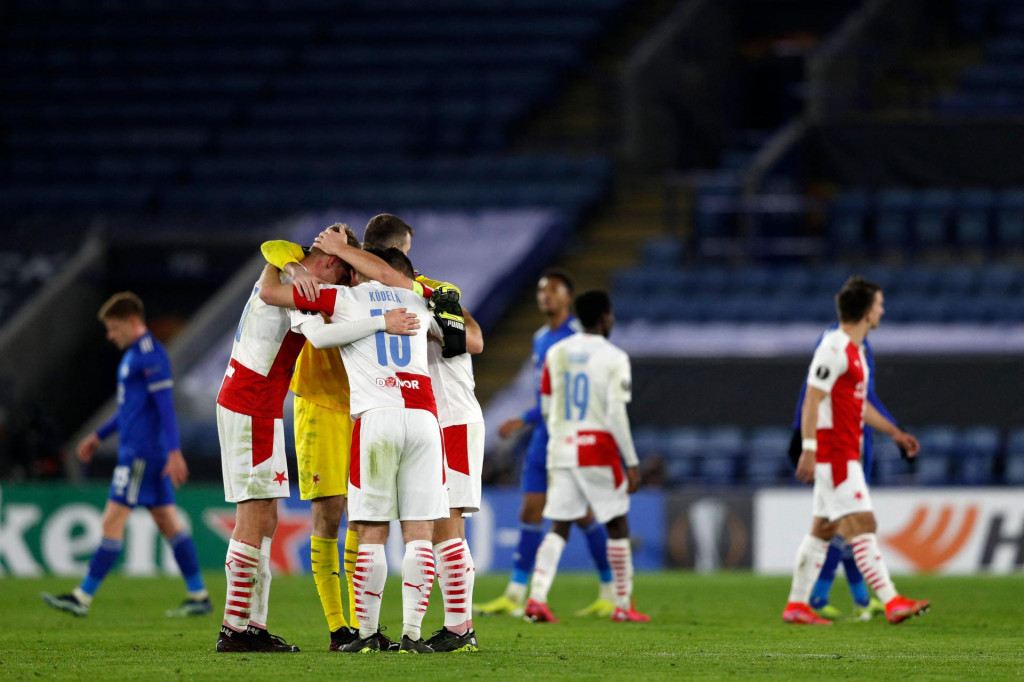 Prague players celebrate their win on the pitch after the UEFA Europa League Round of 32, 2nd leg football match between Leicester City and Slavia Prague at King Power Stadium in Leicester, central England on February 25, 2021. - Slavia Prague won the game and tie 2-0. (Photo by Adrian DENNIS/AFP)