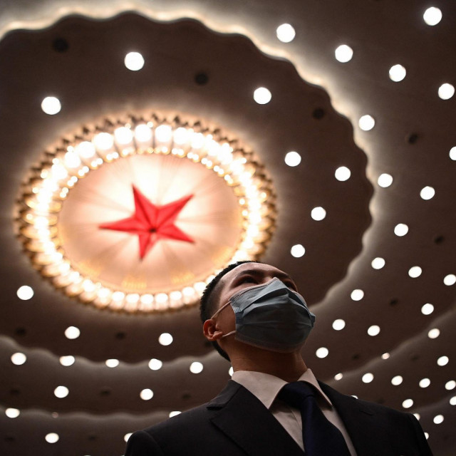 A security personnel watches on after the second plenary session of the National People�s Congress (NPC) at the Great Hall of the People in Beijing on March 8, 2021. (Photo by Noel Celis/AFP)