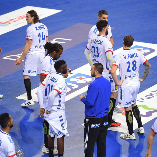 France's team players react at the end of the IHF Men's Tokyo Handball Qualification 2020 match between Portugal and France at the Sud de France Arena in Perols, southern France on March 14, 2021. (Photo by Sylvain THOMAS/AFP)