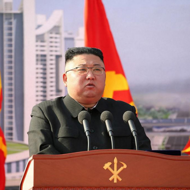 "In this picture taken on March 23, 2021 and released from North Korea's official Korean Central News Agency (KCNA) on March 24, 2021 North Korean leader Kim Jong Un speaks during the ground-breaking ceremony of a construction project for building 10000 apartments in Pyongyang. (Photo by STR/KCNA VIA KNS/AFP)/South Korea OUT/---EDITORS NOTE--- RESTRICTED TO EDITORIAL USE - MANDATORY CREDIT ""AFP PHOTO/KCNA VIA KNS"" - NO MARKETING NO ADVERTISING CAMPAIGNS - DISTRIBUTED AS A SERVICE TO CLIENTS/THIS PICTURE WAS MADE AVAILABLE BY A THIRD PARTY. AFP CAN NOT INDEPENDENTLY VERIFY THE AUTHENTICITY, LOCATION, DATE AND CONTENT OF THIS IMAGE ---/"