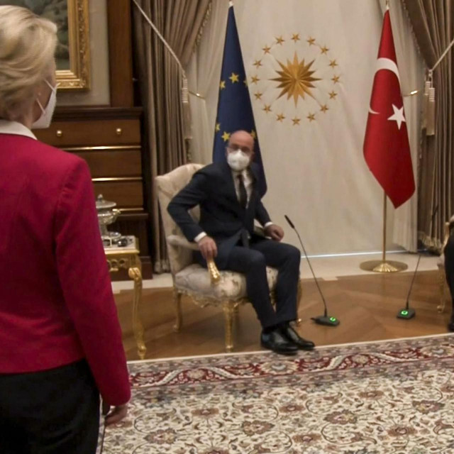 """TOPSHOT - This video frame grab taken from footage released by The Turkish Presidency on April 6, 2021, shows Turkish President Recep Tayyip Erdogan (R) receiving EU Council President Charles Michel (C) and President of EU Commission Ursula von der Leyen (L) at the Presidential Complex in Ankara. - The European Commission hit out April 7, 2021, at a diplomatic snub that left its head Ursula von der Leyen without a chair as male counterparts sat down at a meeting with Turkish President Recep Tayyip Erdogan. Video from the April 6, 2021, encounter in Ankara showed von der Leyen flummoxed as the Turkish leader and European Council president Charles Michel took the only two chairs in front of their flags. (Photo by -/various sources/AFP)/RESTRICTED TO EDITORIAL USE - MANDATORY CREDIT """"AFP PHOTO /TURKISH PRESIDENTIAL PRESS SERVICE """" - NO MARKETING - NO ADVERTISING CAMPAIGNS - DISTRIBUTED AS A SERVICE TO CLIENTS"""