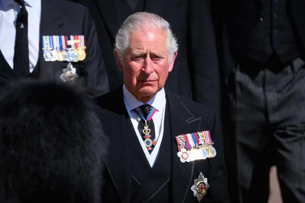 Britain's Prince Charles, Prince of Wales follows the coffin during the ceremonial funeral procession of Britain's Prince Philip, Duke of Edinburgh to St George's Chapel in Windsor Castle in Windsor, west of London, on April 17, 2021. - Philip, who was married to Queen Elizabeth II for 73 years, died on April 9 aged 99 just weeks after a month-long stay in hospital for treatment to a heart condition and an infection. (Photo by LEON NEAL/POOL/AFP)