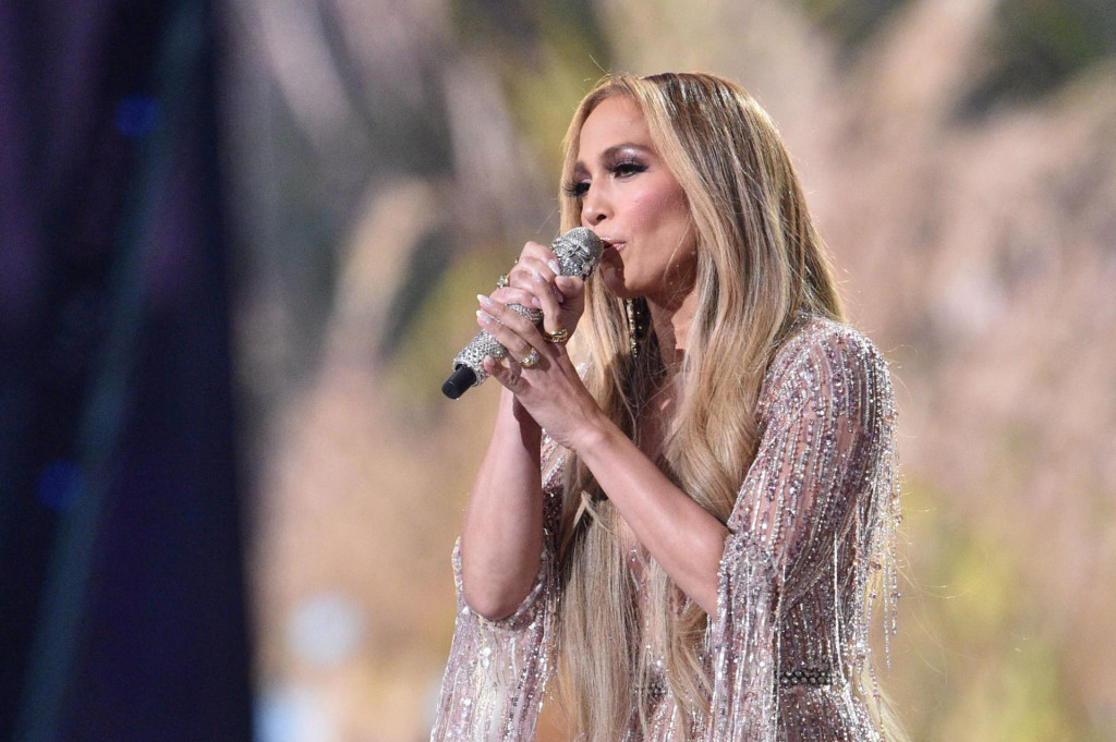 """US singer Jennifer Lopez performs onstage during the taping of the """"Vax Live"""" fundraising concert at SoFi Stadium in Inglewood, California, on May 2, 2021. - The fundraising concert """"Vax Live: The Concert To Reunite The World"""", put on by international advocacy organization Global Citizen, is pushing businesses to """"donate dollars for doses,"""" and for G7 governments to share excess vaccines. The concert will be pre-taped on May 2 in Los Angeles, and will stream on YouTube along with American television networks ABC and CBS on May 8. (Photo by VALERIE MACON/AFP)"""