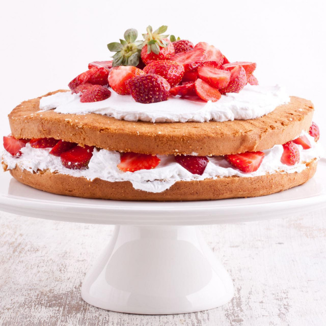 strawberry cream cake on a white background